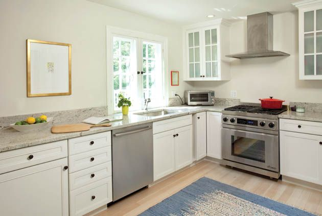 The long wall of the kitchen design with no upper cabinets helps open up the space Kitchen design without upper cabinets