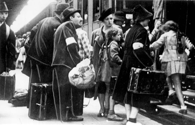 Cracow, Poland, Jews at the train station being deported from the city.  Belongs to collection: Yad Vashem Photo Archive  Additional Informa...