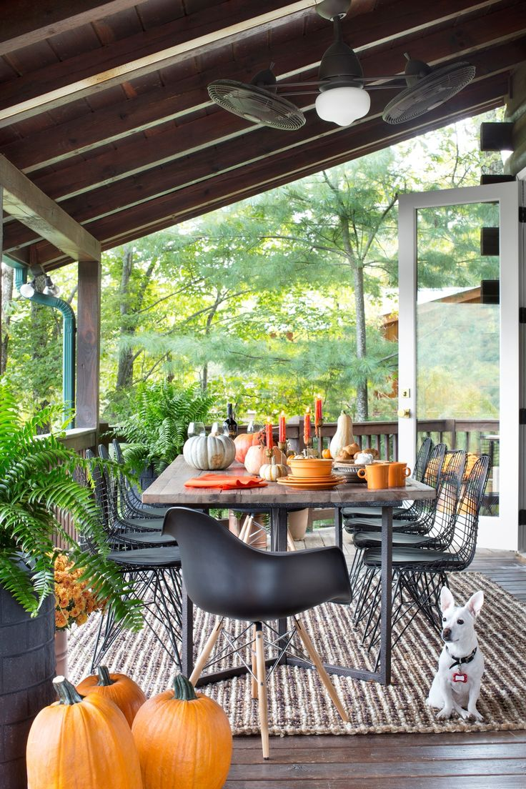 Most homeowners fret over having their fix-ins perfect and tables set just right for Thanksgiving. Well, interior designers are likely to be more concerned with their furniture and lighting than their gravy and greens. At least that's the case at Brian Patrick Flynn's house in the mountains. Take a gander at how Brian whipped the dining and living areas of his raised deck into top-notch shape, with a mix of midcentury modern and rustic furnishings.
