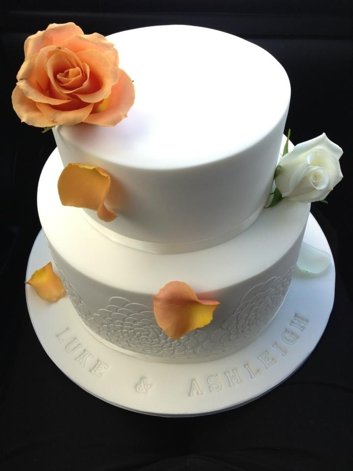 Elegant wedding cake with personalised touch... The couples names embossed in fondant .