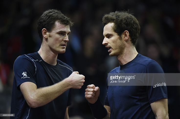 Britain's Jamie Murray (L) and Britain's Andy Murray celebrate after scoring during the doubles tennis match on the second day of the Davis Cup final between Belgium and Britain at Flanders Expo in Ghent on November 28, 2015.