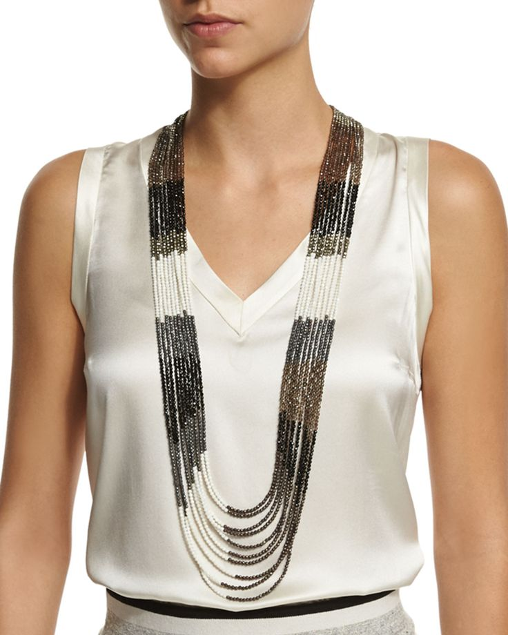 Brunello Cucinelli multi-strand beaded long necklace in black, taupe, and white. Beaded strands with pyrite, quartz, agate, white coral and hematite. Leather closure. Made in Italy of imported materials.