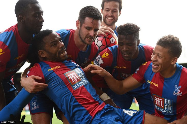 Overcome with emotion, Jason Puncheon is joined by Palace team-mates as he celebrates in front of the home fans after his left-footed finish curled deliciously into the Norwich net
