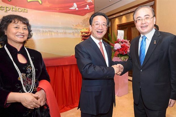 Dr Huang (centre) and his wife, Zhao Shumei (left), welcoming Wee to the China National Day reception at Shangri-La Hotel Kuala Lumpur.