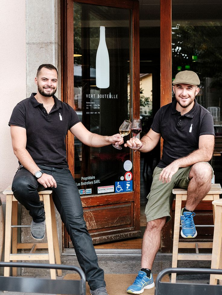 The sommelier and the chef, owners and great friends, sharing a glass of wine on the steps of their passion project and wine bar. Vert Bouteille wine bar geneva.
