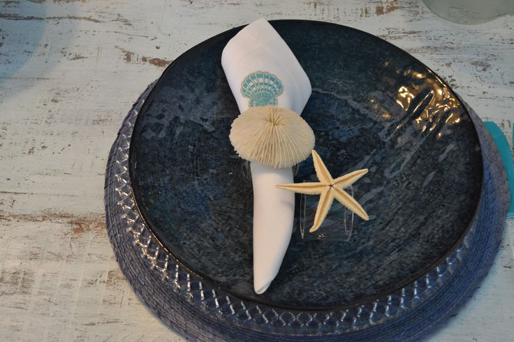 Ceramic plate.Napkin ring with natural shell.
