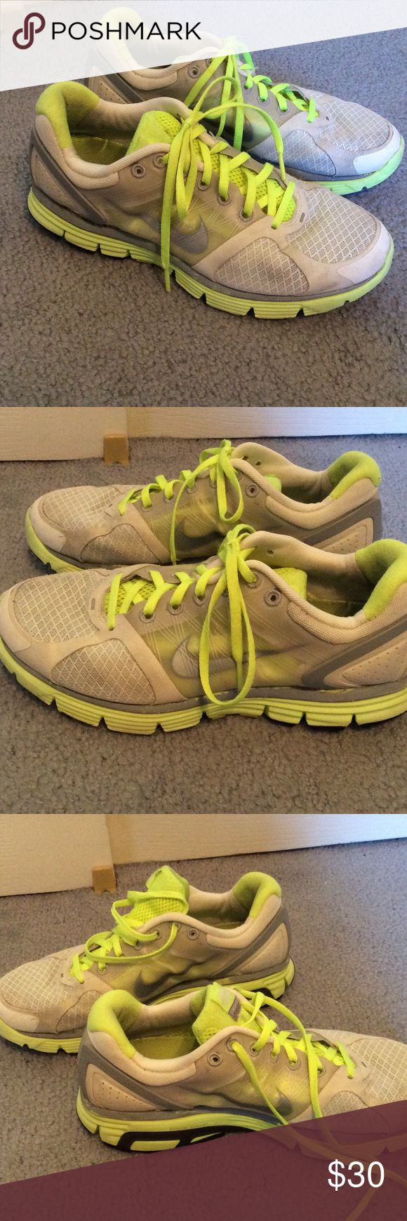 Nike LunarGlide 2 Nike Lunar Glide 2 tennis shoes. These have plenty of life left. Only walked in, never ran in. Minor wear, no rips or holes. Size 8.5. Very comfortable and have dynamic support. Neon yellow and silver, great for running at dawn or dusk. Nike Shoes Athletic Shoes