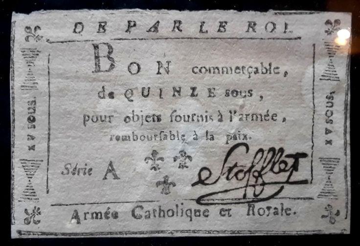 """Bons Stofflet, papiers-monnaie de quinze sous, """"commerciables"""" pour objets à fournir à l'armée vendéenne et remboursables à la paix.   Au retour de la Virée de Galerne, Stofflet  avait repassé la Loire à Ancenis le 20 décembre 1793. Stofflet avait organise au coeur de la forêt dites de Vezins, un refuge central, avec imprimerie.  À Maulévrier, le 7 octobre 1794, Stofflet prit un arrêté, créant 6 millions de papiers monnaie."""