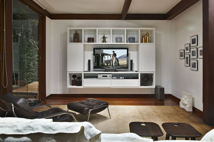 Exterior: Astonsihing Family Room Near Wooden TV Stand Along With Eames Chair On Yellow Carpet Inside Garden House With Corner Fireplace from Wooden Material for House Providing Delicate Exterior Look