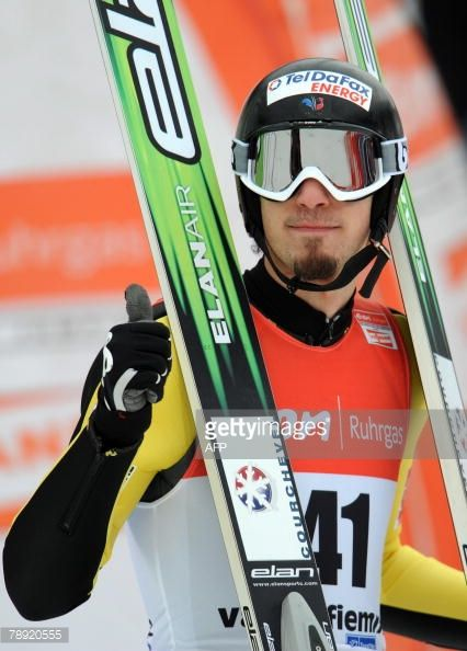 French Emmanuel Chedal gives a thumbs up on finish area of Large Hill Individual jump in the World Nordic Ski Championships in Predazzo Val di Fiemme...