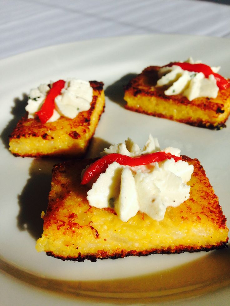 Grilled polenta crostini with herbed chèvre and roasted red bell ...