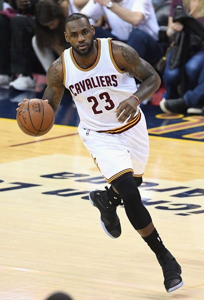 LeBron James Photos - LeBron James #23 of the Cleveland Cavaliers dribbles the ball during the first half against the Golden State Warriors in Game 3 of the 2016 NBA Finals at Quicken Loans Arena on June 8, 2016 in Cleveland, Ohio. NOTE TO USER: User expressly acknowledges and agrees that, by downloading and or using this photograph, User is consenting to the terms and conditions of the Getty Images License Agreement. - 2016 NBA Finals - Game Three