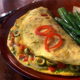 Spanish Omelet with Olives & Red Pepper  Serve this tasty Spanish dish as a protein-packed breakfast or simple supper. IncredibleEgg.org/Recipes