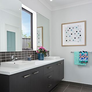The Willow Display by Homebuyers Centre Victoria #bathroominspo #bathroomdesign #caroma #inspiringbathrooms #doublebasins #vanity #whiteandgrey #tiledsplashback #weeklyhometrends #artwork #popsofcolour #styling #newhome #building  http://vic.homebuyers.com.au/