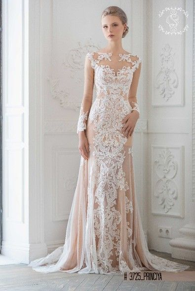 Wedding dress with illusion necklane and lace sleeves in champagne colour perfect choice for Winter wedding.