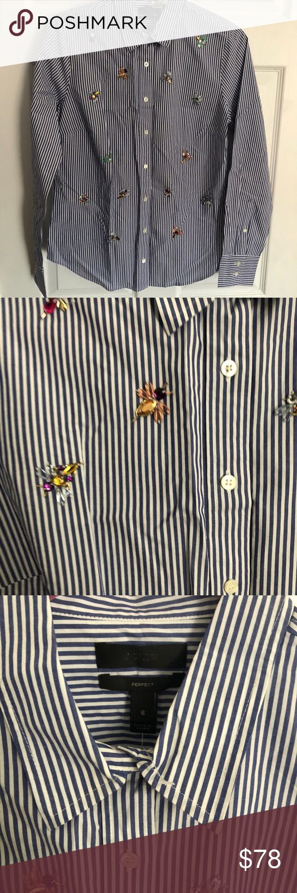 J. Crew Perfect shirt with bee embellishment Our perfect shirt features precisely placed darts for a slimming, waist-defining fit that's more tailored and polished than our boy shirt. This one features hand-embellished bees for a quirky, perfectly J.Crew take. For more ways to wear it, watch our Style Hacks video now.  Cotton. Long roll-up sleeves. Functional buttons at cuffs. Button placket. Dry clean. Import. Item F4992. J. Crew Tops Button Down Shirts