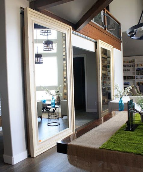 Sliding Barn Doors: For a bit of the unexpected, use huge full length mirrors in place of barn doors.