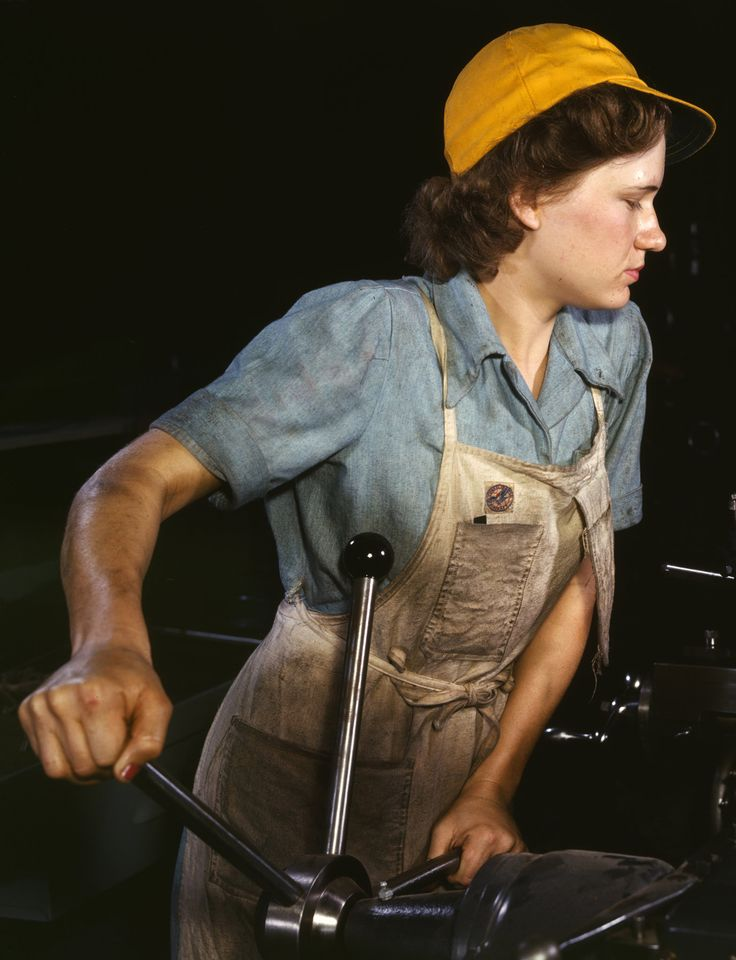 A female factory worker in 1942, Fort Worth, Texas. As the blue chambray shirt has evolved into a staple of casual style, its 'blue collar' has become a slippery social construct.