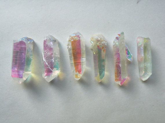 One Opal Aura Quartz Point - These are so beautiful. Anyone have one? They remind me of Angel Aura Crystals. I love them.