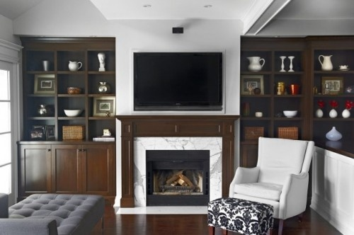Legs on fireplace need to be a bit wider but the idea is nice and the built-ins are great.  Love the dark stain and symmetry!