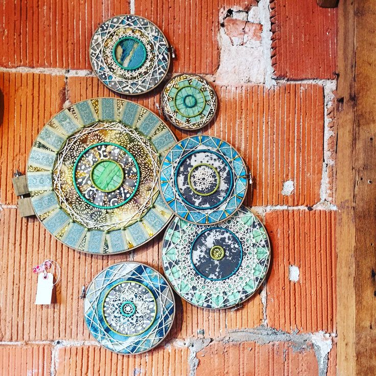 Mixed media art created with embroidery & quilting hoops, fabric remnants, string & vintage doilies - sold in San Diego, CA store