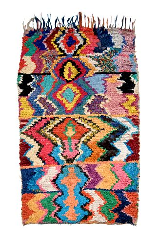 The style in question is called boucherouite, (pronounced boo-shay-REET) a word derived from a Moroccan-Arabic phrase for torn and reused clothing. The carpets it describes, made by women for domestic use, are basically variations on the humble rag rug, without the humility.