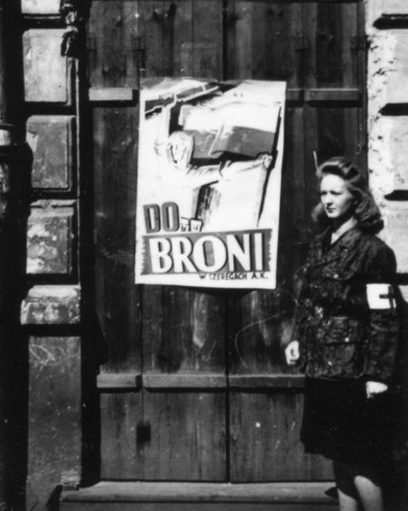 Warsaw Uprising A Polish partisan standing next to an uprising poster on Muranowska Street