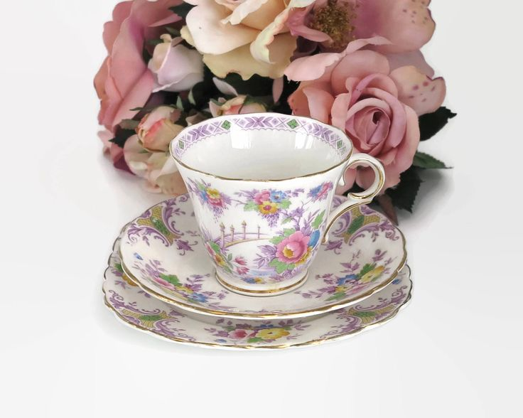 Vintage Colclough cup, saucer, and plate with pattern of multi colored flowers, lots of purple, bone china, England, mid 20th century by CardCurios on Etsy