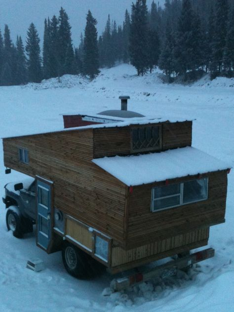 Mark turned an abandoned truck into a cozy small RV with room for his ski equipment and a wood-burning stove.