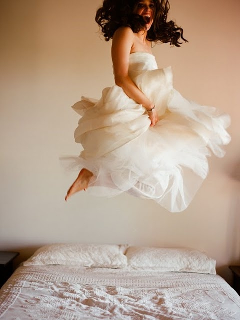 bride jumping in dress