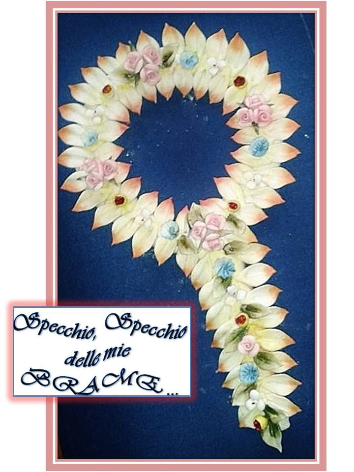 Mirror entirely handmade with porcelain leaves and flowers.