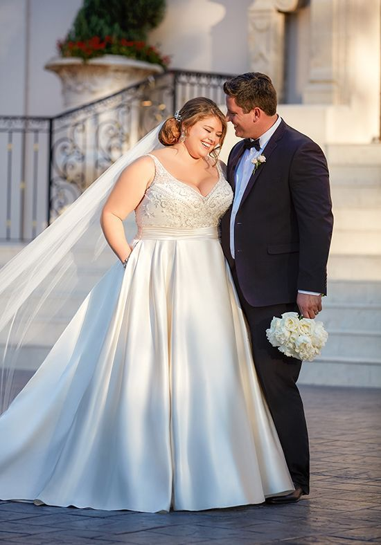 This plus size ball gown with sash wedding dress from Stella York is full romance! Dolce satin creates a stunning silhouette from beaded straps and sweetheart neckline to voluminous skirt. #satinweddingdresses