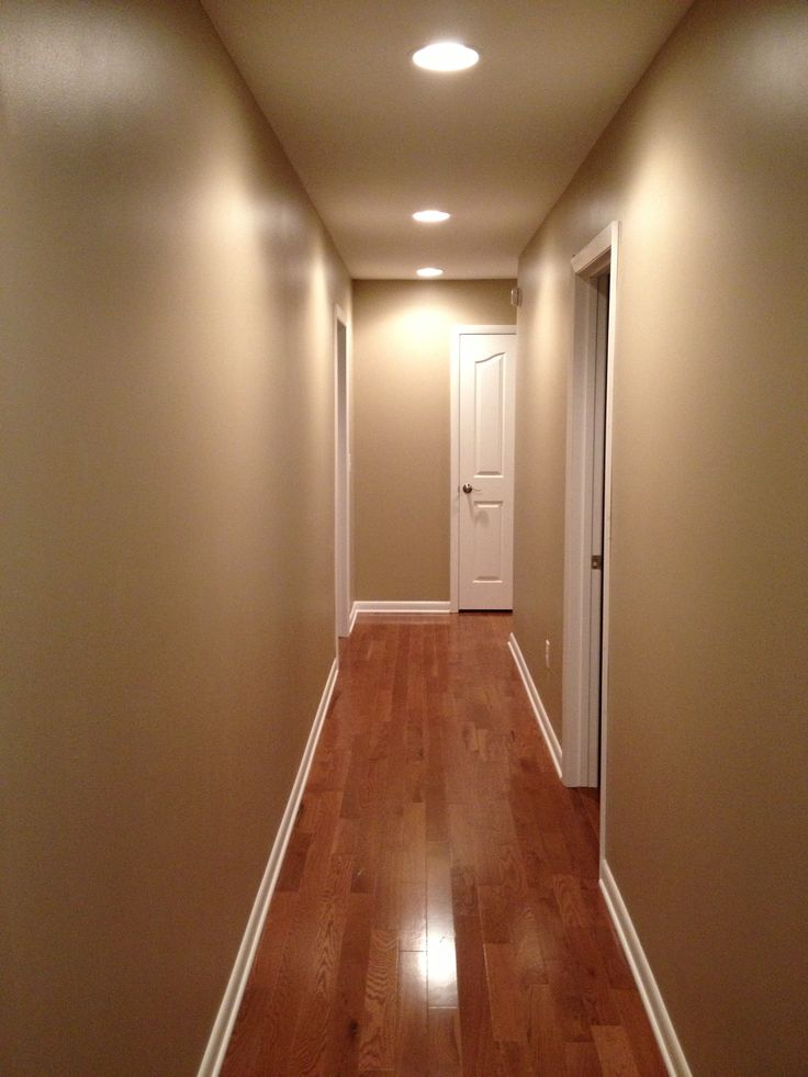 My beautiful hallway.  We used Pavillion Beige paint from Sherwin Williams. Love!!