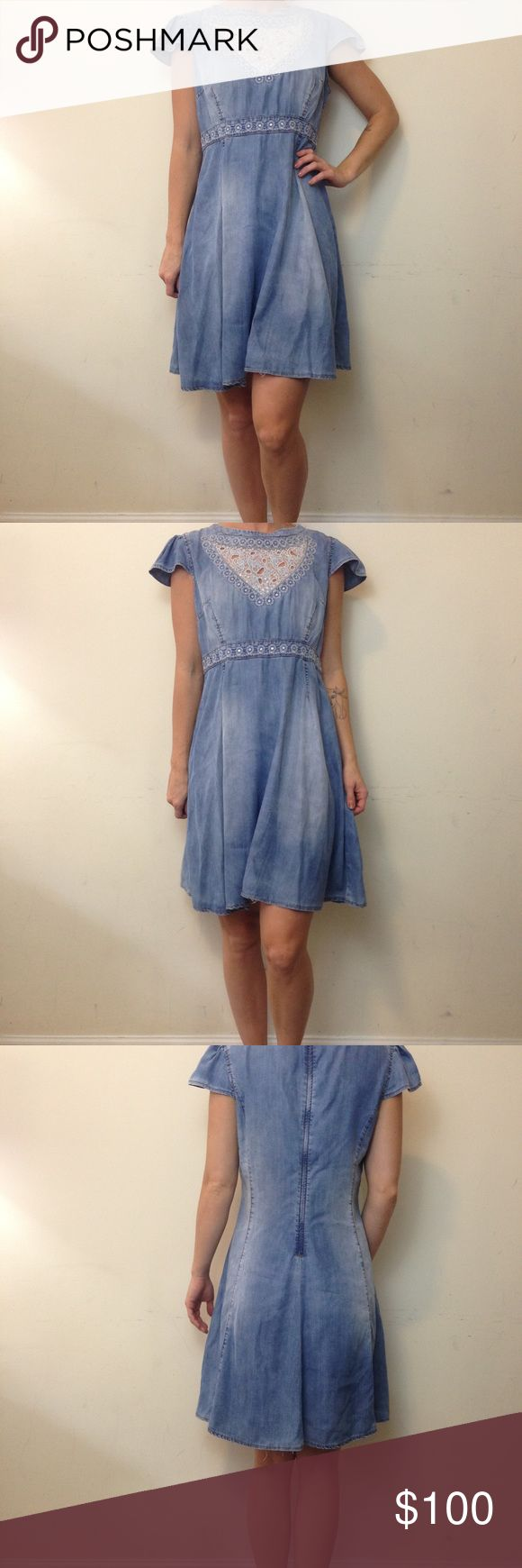 Love Moschino Denim Sequin Cut Out Skater Dress Love Moschino Denim dress with short sleeves and a cut out Panel in the front and Sequin Detail- has some pink fading on the side waist very faint from a handbag that rubbed off. Super cute and high fashion. Size large and is perfect for all seasons! Love Moschino Dresses