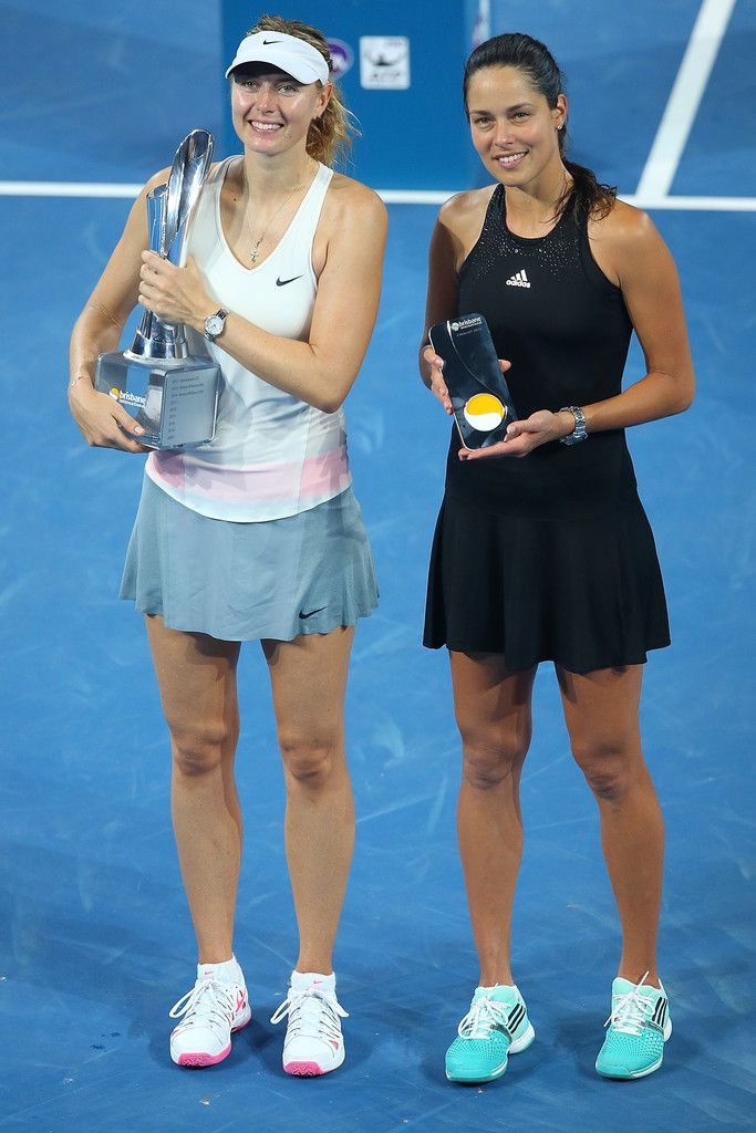 Winner Maria Sharapova of Russia and runner up Ana Ivanovic of Serbia pose after the Womens final during day seven of the 2015 Brisbane International at Pat Rafter Arena on January 10, 2015 in Brisbane, Australia.