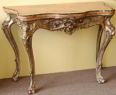 Northern Italian, Rococo period, silver leaf console table: With ochre color marble top having a green border.  Mid-18th century.