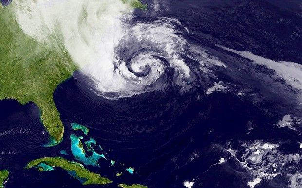 A satellite image of Hurricane Sandy, pictured at 00:15 UTC, churns off the east coast of the US Photo: NASA via Getty Images  29 Oct 2012