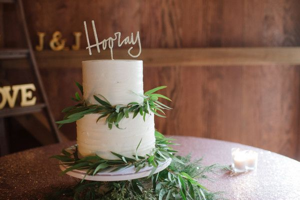 "Elegant wedding cake idea - two-tier, buttercream-frosted wedding cake with greenery and sparkly ""Hooray"" cake topper {Shutter Sam Photography}"