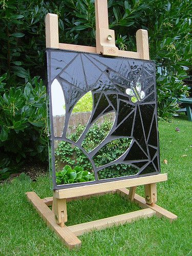 Mosaic garden mirror (31 x 31cm / 1' x 1'). Designed and handmade using stained glass and recycled mirror. I've added wire and bead to add interest to the butterfly.