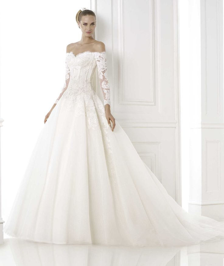 PRONOVIAS ~ 2015 Glamour ~ BESPIN Style 16/21 ~ Tulle, mermaid-style dress with gemstone embroidered appliqués. Lace-up bodice with wrap-around neckline and scalloped edge. Long sleeves with lace appliqués.