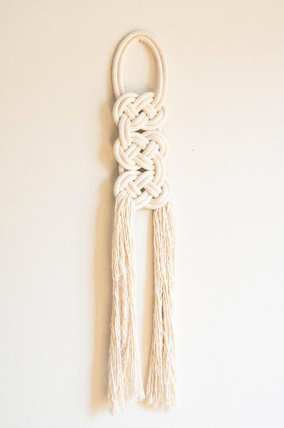 The birka knot has been designed to resemble flat knotted and woven metal decorations found on clothing once worn by Norsemen. Wall hanging pictured is a medium. Please select your preferred size. Small: 7 x 22 Medium: 9.5 x 30 Large: 12 x 40 Each knot is made to order from Canadian