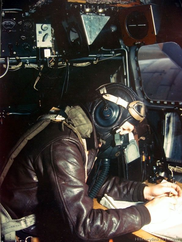 "In the nose of an 8th AF Boeing B-17 ""Flyiner Fortress"" the navigator charts the course to a German Industrial target."
