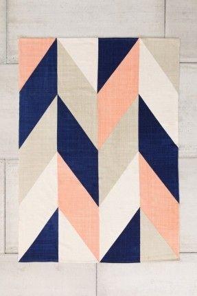 Girls Nursery color scheme: navy blue, peach, beige.  Rug: Assembly Home Chevron Flip Handmade Rug - Urban Outfitters 5x7