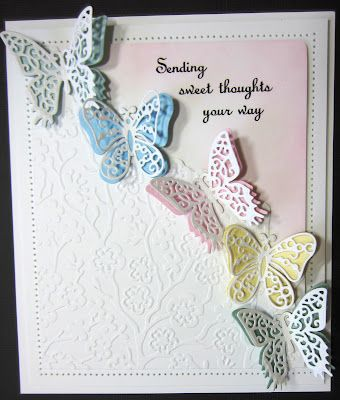 PartiCraft (Participate In Craft): Nice butterfly card with some embossing, die cuts, distress inks, and paper piercing.