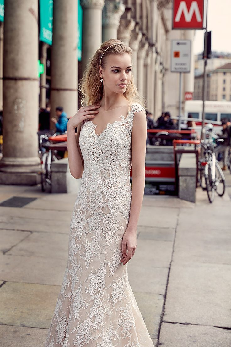 Eddy K Milano Style MD222: beautiful fit-n-flare with cap sleeves,  illusion back and neckline. Made with lace, available in ivory/ivory or champagne/ivory.