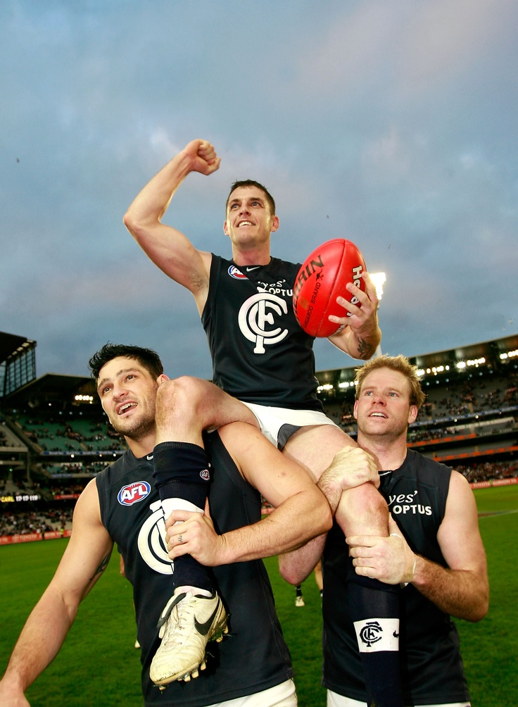 Scotland in his 150th game is chaired off by (L-R) Brendan Fevola and Nick Stevens after the 2008 Round 12 match against Collingwood at the MCG.