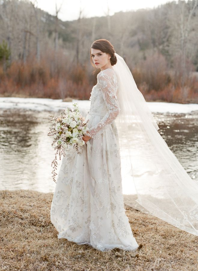 Stunning winter lace embellished long sleeve wedding gown: http://www.stylemepretty.com/2016/09/14/laurie-arons-2016-wedding-planner-masterclass-part-ii/ Photography: Jose Villa - http://josevilla.com/