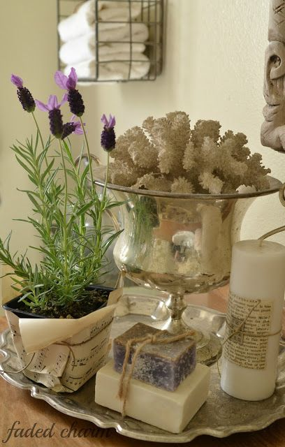 Silver and soaps and coral and lavender = bath vignette.
