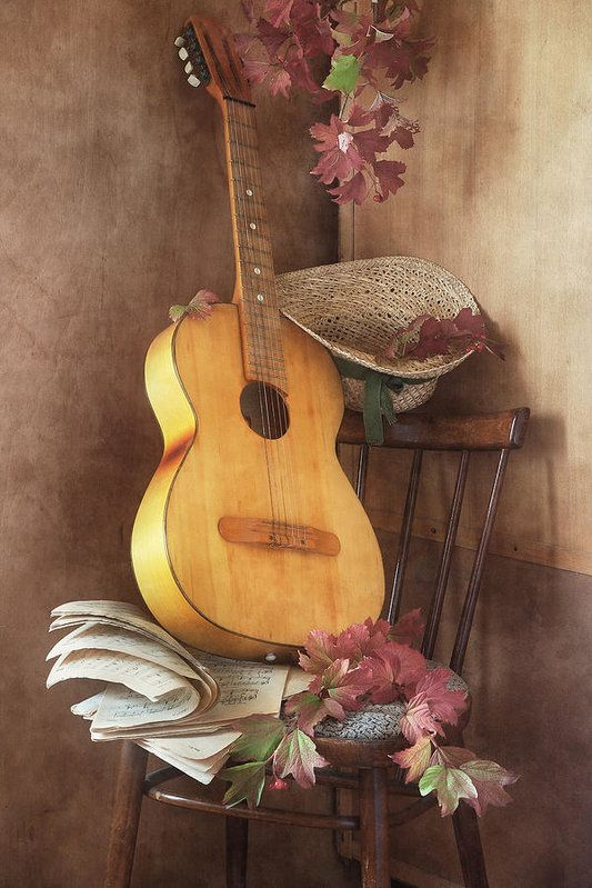 http://pixels.com/products/play-your-autumn-song-nikolay-panov-art-print.html  Autumn, still life, photography, old, music, book, yellow, guitar, retro, chair, red, leaves, wooden, fall