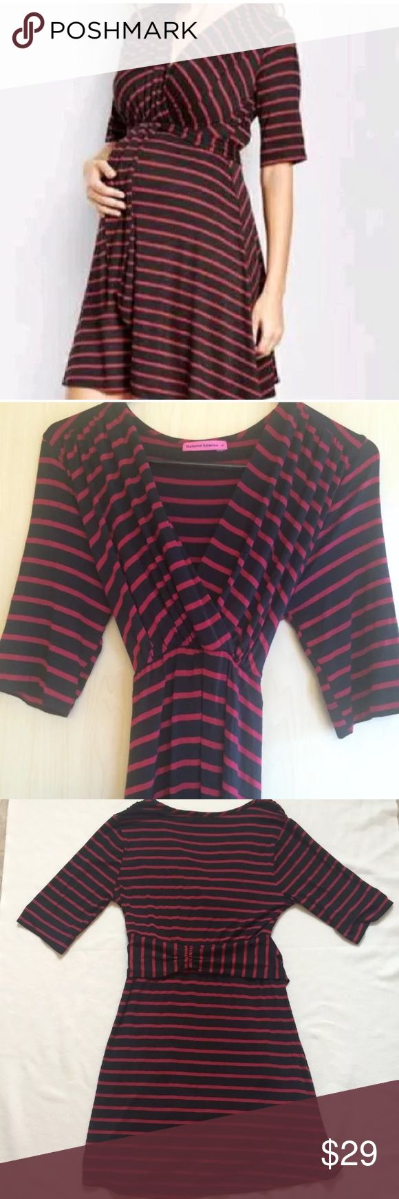 """Maternal America Maternity Dress Excellent used condition, no flaws Colors- navy and wine red  Top portion of dress is fitted, bottom is loose and flowy   Vibrant stripes energize a soft, stretch-knit dress styled with a nursing-friendly V-neck. Dual waist ties can be worn in the front or back for a versatile style that flatters your shapely silhouette.  37 1/2"""" length (size Large) 96% rayon, 4% spandex. Hand wash cold, dry flat. made in the USA. Large= pre pregnancy 12-14 Retail $100…"""